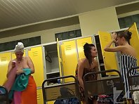 Lo1300# Three young girls dress up and wiped off after a shower in the pool locker room. Our opret