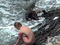 Nu1580# Nudists have a rest on the beach. They think that nobody sees and go completely naked. But