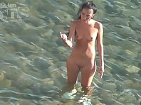 Nu1837# Girl dancing in the water. She teases his friend. She wants to have sex. But the guy does no