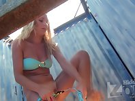Bc2332# Tanned blonde with a tight body changes her swimsuit. Another great model for spy camera sho