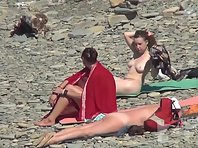 Nu2013# The company of three girls is sunning on the beach. They substitute their bodies under the s