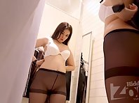 Sp2425# The girl tries on bras. On her tights, worn on a naked body. This combination looks very bea