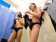 Sp2252# Beauty tries on bras. Some are clearly small. It's interesting to watch her stuff her tits t