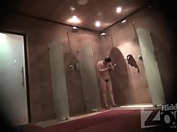 Sh1646# A woman is washing in the shower. In the opposite corner a hidden camera is installed and ph