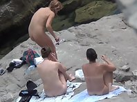 Nu2252# A company of several girls resting among the coastal cliffs. They think that no one sees the