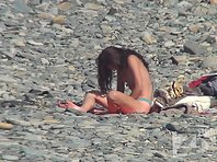 Nu1423# Nudist beach gradually filled with people. Another two girls completely undressed and fram
