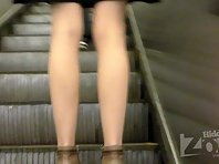 Up2119# Slim blonde in a short brown skirt. Smart ass and white panties and pantyhose closeup. Ano