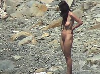 Nu2073# The girl and the young man retired among the coastal stones. They decided to swim naked and