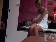 Lo1384# A girl sits close to the locker room voyeur cam. When she was changing her panties on her
