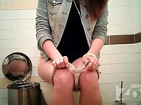 Wc1872# Young girl in white panties pee sitting on the toilet. The cafe in the toilet can shoot gr