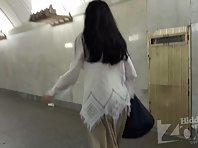 Up2930# Upskirt brunette in a long beige skirt. Our operator brazenly put his hand with the camera u