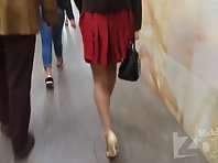 Up2607# Blonde in a short cherry skirt. In the lens of the hidden camera came her shaved crotch in w