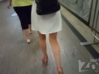 Up2854# Under the skirt of a slender girl in a short white sundress. Gorgeous ass and shaved crotch