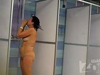 Sh1320# Tanned woman taking a shower right in front of our hi