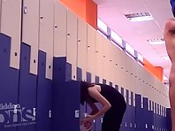 Lo1542# Woman smears her body cream. She turns to the locker room voyeur cam at first at front and
