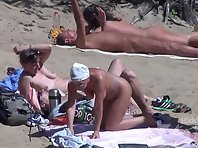 Nu1851# The company nudists resting on the beach. Their naked bodies on display. And we admire these