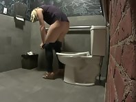 Blonde Using Bathroom