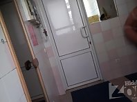 Lo1441# Hidden camera in the dressing room saunas. Young tanned babe took off her bathing suit and