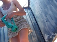 Bc1692# Young girl in a lace skirt changing her panties, repeatedly showing us her pussy. Beach ca