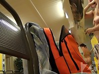 Lo1298# Two women dressed in the pool locker room. Our hidden camera shoots a close-up of one of t