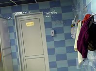 Lo1464# Hidden camera in the pool locker room. Tanned woman takes off her white swimsuit right acr