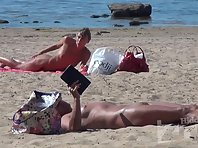 Nu1708# Naked woman sunbathing on a nudist beach. Nude beach voyeur cam explores in detail their b