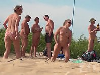 Nu1690# On the nudist beach there are always men who are looking at naked women. In this video we