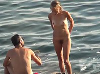 Nu2310# We continue to watch a couple of nudists. The girl got up and we can clearly see her shaggy