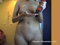 Pv516# Tanned woman completely undressed and smeared with cream in front of the mirror. In the lens