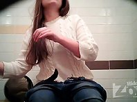 Wc1800# Beauty in a white sweater and jeans. She piss sitting down. Great view from the front girl