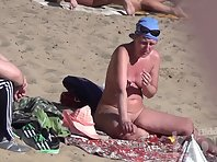 Nu1863# Woman on a nudist beach shows us the body. She has a good chest and neat shaved pussy. Next
