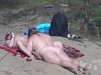 Nu2181# The woman continues to do blowjob to her companion, and he looks around contentedly. All nud
