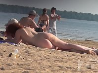Nu1337# Another company got in the picture of nude beach voyeur camera. Women young and beautiful,