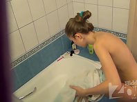 Sp1592# The girl wipes her burning body with a towel. She is neat everywhere, such girl is a very