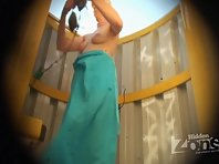 Bc1626# Not a very young woman dresses tiger swimsuit and shows us her body in this beach cabin vo