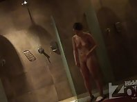 Sh1671# One of the girls stayed in the shower. She turns under the shower and washes herself both in