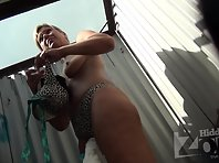 Bc2323# Tanned woman changes swimsuit in beach cabin. Excellent close-up shots. Beautiful tits and s
