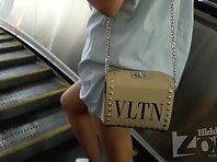 Up2869# Under the skirt of a tanned girl in a blue sundress. Our operator several times put his hand