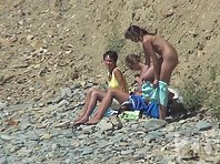Nu1298# Three young beauty came to the nudist beach. They undress completely and start tanning. Ou