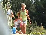 Nu1110# Blonde undresses at the nudist beach, our operator captures her every move.