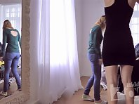 Sp1779# Girls dressing in front of a mirror. We see them in their underwear. Typically, these naug
