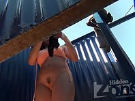 Bc2094# Brunette with beautiful tits dresses a swimsuit in the beach cabin. Beautiful hairstyle on a