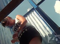 Bc1676# Young girl with big boobs. Our beach cabin voyeur camera took off her tanned body and big