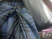 Up2133# Brunette in a wide blue skirt. Our cameraman filmed close-up of her crotch and shaved crot