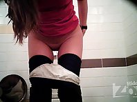 Wc1758# Young babe with a shaved pussy peeing standing and widely spread her buttocks. View from t