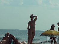 Nu1340# Nude beach voyeur camera continues to admire the beauty of the girl. Her boobs are very ne