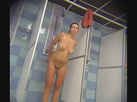 Spying on a tanned beauty in the shower