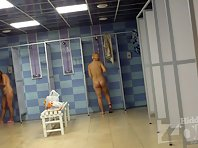 Sh1387# In the shower added a few more women. They take off their bathing suits and get into the s