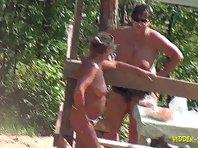 Nu1061# A slender young woman sunbathing on a nudist beach
