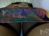 Up2189# Tanned brunette in bright multi-colored dress. Round ass tanned and shaved crotch in white